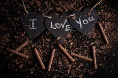 I love you, written chalk on a blackboard. Happy Valentines Day. Valentine`s Day theme. Mother`s Day. Chalk lettering on stock image