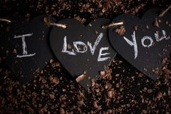 I love you, written chalk on a blackboard. Happy Valentines Day. Valentine`s Day theme. Mother`s Day. Chalk lettering on royalty free stock images