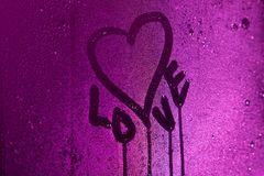 I love you written on condensation glass with purple light Royalty Free Stock Image