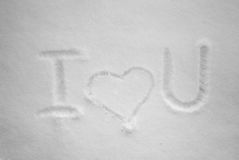 I love you written by hand in the fresh snow at sunny day. Royalty Free Stock Photos