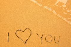 I Love You - written by hand in sand on a beach. Stock Photos