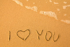 I Love You - written by hand in sand on a sea beach Royalty Free Stock Images