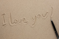 I love you written in pen on the sand Royalty Free Stock Images