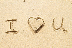 I love you written in sand Royalty Free Stock Photos