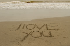 I love you written in the sand. I love you sign on the beach Royalty Free Stock Images