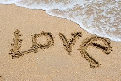 I love you written in sandy beach royalty free stock image
