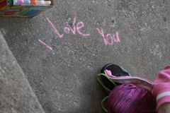 I love you written in sidewalk chalk stock photo