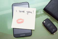 I love you written on a ticket with kiss with lipstick  on the s. Mart phone Stock Image