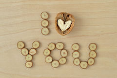 I love you. Written with walnut and wood slices Stock Photo