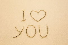 I love you written on wet yellow beach sand Royalty Free Stock Photo
