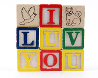 I Luv You. 'I LUV YOU' spelled with toy blocks Royalty Free Stock Images