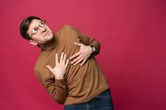 I`m afraid. Fright. Portrait of the scared man on trendy pink studio background. Male half-length portrait. Human emotions, facial expression concept royalty free stock photo