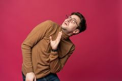 I`m afraid. Fright. Portrait of the scared man on trendy pink studio background. Male half-length portrait. Human emotions, facial expression concept royalty free stock image