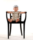I´m the boss. Little boy with a chair Stock Photo