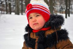 I'm cold. A cute child unhappy because of the cold stock photo