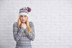 I`m freezing. Portrait of beautiful blond woman in winter cap freezing Royalty Free Stock Images