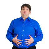 I'm full. Closeup portrait of really full man, stuffed, holding belly, about to burst at seams, had too much for lunch isolated on white background. Negative Stock Image