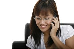 I'm Glad You Called. A young lady using a mobile phone Royalty Free Stock Image