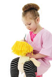 I`m Gonna` Comb This Dolly`s Hair Stock Images