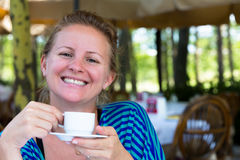 I'm happier with my Turkish Coffee. Nothing makes me happier  than a cup of Turkish coffee in the mornings. A large smile comes from a Turkish girl Stock Photos