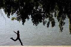 I'm so Happy !. Silhouette of happy woman by the river Royalty Free Stock Photography