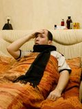 I`m ill series. White male in bed with high temperature having a headache Stock Photo