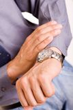 I`m late. Bussinessman looking at the watch, high key, focus on the watch royalty free stock photo