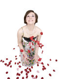 I'm In Love!. Beautiful brunette woman throwing flower petals in the air with a look of joy. Isolated on white Royalty Free Stock Images