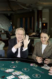 I'm Married. Jerry Springer shows off his wedding ring as Barbara Padilla laughs royalty free stock photos
