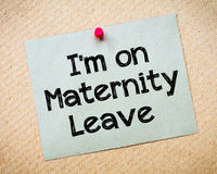I'm on Maternity Leave Message. Recycled paper note pinned on cork board.I'm on Maternity Leave Message. Concept Image royalty free stock photography