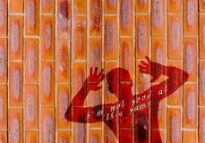''I'm not good at this game'' depressed silhouette of the man.Shadow of a man on red bricks wall background Stock Photos