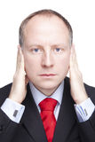 I'm not listening. Businessman covering his ears isolated on white Stock Images