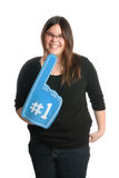 I'm Number 1. A smiling teenage girl is holding a large foam hand showing that she is number one, isolated against a white background Stock Images