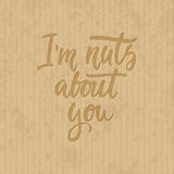 I`m nuts about you - hand drawn lettering phrase  on the cardboard grunge background. Fun brush ink inscription Royalty Free Stock Photos
