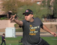 USA, AZ: Disc Golfer - One of Those Disc Golf People. This disc golfer advertises his sport. He has just thrown his disc and still is fully concentrated on his stock photos