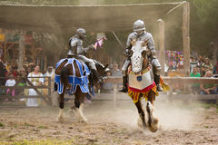 Im out of here!. Two Knights battle it out at the Sherwood Forest Faire in McDade, Texas Stock Photo
