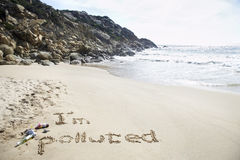 I'm Polluted Written In The Sand At Beach Stock Images