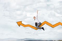 I'm reaching up to success!. Young businessman riding graph arrow going up Stock Image