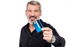 I'm ready to shop !. Senior man showing his credit card to camera Royalty Free Stock Images