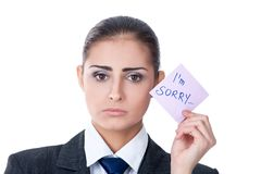 I'm sorry. Sad young woman holding a note saying sorry royalty free stock photo