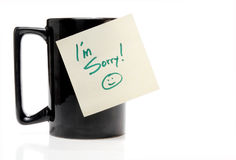 I'm Sorry. A coffee mug with an Im Sorry note Stock Photo