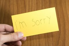 I`m sorry handwrite on a yellow paper with a pen on a table. Composition royalty free stock photography