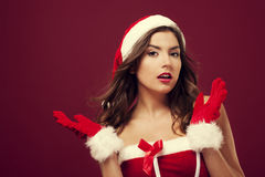 I'm sorry, I don't know. Confused santa girl on red background royalty free stock photography