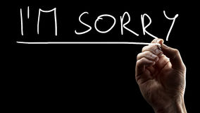 I'm sorry. Mel hand writing I'm sorry on black virtual screen. Conceptual of regret and expressing condolences stock photos