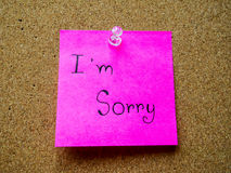I'm sorry on post it note. I'm sorry in post it note on wooden board Royalty Free Stock Photos