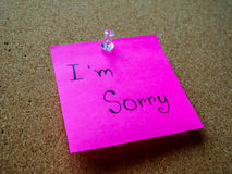 I'm sorry on post it note. I'm sorry in post it note on wooden board Royalty Free Stock Photo