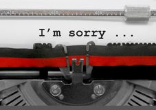 I m Sorry text by the old typewriter on white paper. I`m Sorrytext written by an old typewriter on white sheet Stock Photos