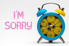 I`m sorry on a white background. Retro alarm clock. Blue stock images