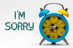 I`m sorry on a white background. Retro alarm clock. Blue stock image