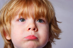 I'm Two. Young boy pouts at the camera Stock Images